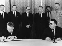U.S. Ambassador Llewellyn E. Thompson, left, signs nuclear non-proliferation treaty as Soviet Foreign Minister Andrei A. Gromyko watches in Moscow, Russia, on July 1, 1968. Standing, left to right are, Embassy Political Counsellor David Klien, U.S. Embassy Scientific Attache Christopher Squire, U.S. Embassy Political Officer and Chief Translator Alexander Akalovsky, Soviet Premier Alexei N. Kosygin, unidentified Soviet Translator and Soviet Defense Minister Andrei A Grechko.  (AP Photo)
