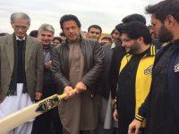 Imran Khan holding Peshawar Zalmi branded bat.