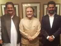 Nabil Gabol, left, is standing with former president Asif Ali Zardari, center.