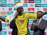 Darren Sammy receiving his man of the match award at PSL Final while wearing traditional Pakhtun turban.