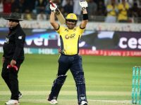 Kamran Khan celebrating his century.