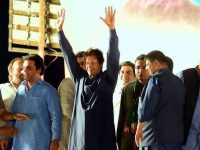 Imran Khan waving to supporters gathered at Parade Ground Islamabad.