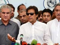 File photo of Imran Khan at a press conference with Shah Mehmood Qureshi (left) and Jahangir Tareen.