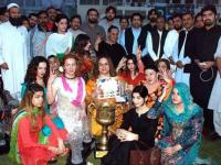 A group of transgender posing for a picture at a the culmination of a sports event in KP.