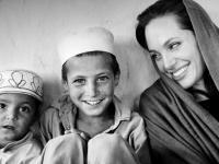 JALALABAD, AFGHANISTAN - OCTOBER 22: UNHCR (United Nation High Commissioner for Refugee) Good Will Ambassador Angelina Jolie is seen during her visit to Afghan returnees from the recently closed Jallozai camp in Lower Skeikh Mesri in Jalalabad on October 22, 2008 during her three days visit to Afghanistan. (Photo by Marco Di Lauro/Getty Images)